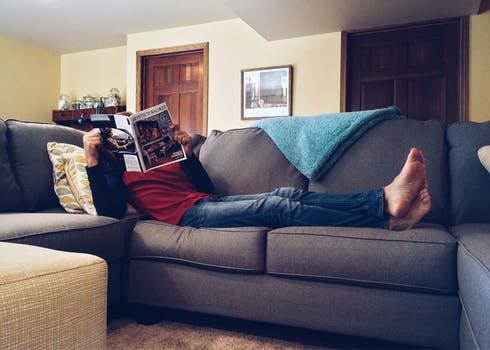 Man sitting on sofa that has undergone upholstery Glasgow