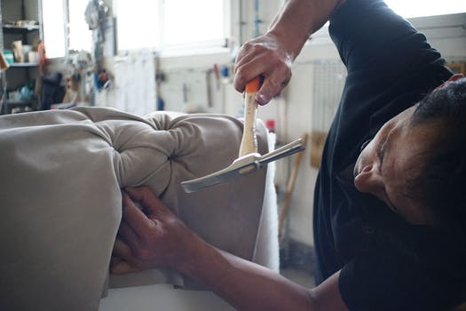 Man completing upholstery Glasgow